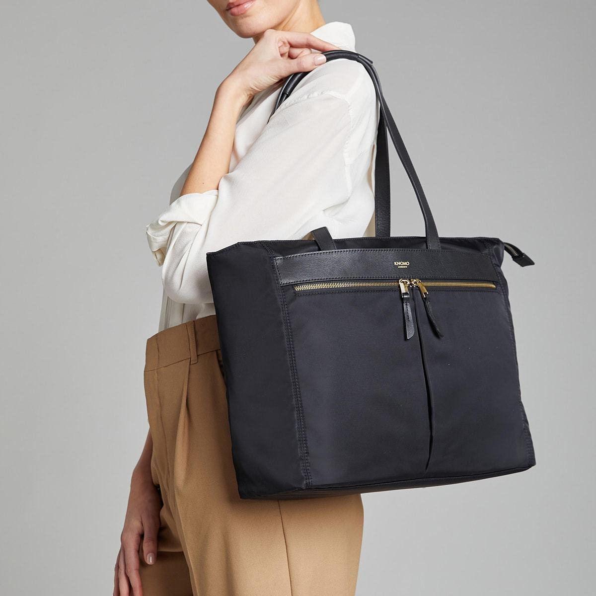 "KNOMO Grosvenor Place Tote Female Model Holding Over Shoulder 14"" -  Black 