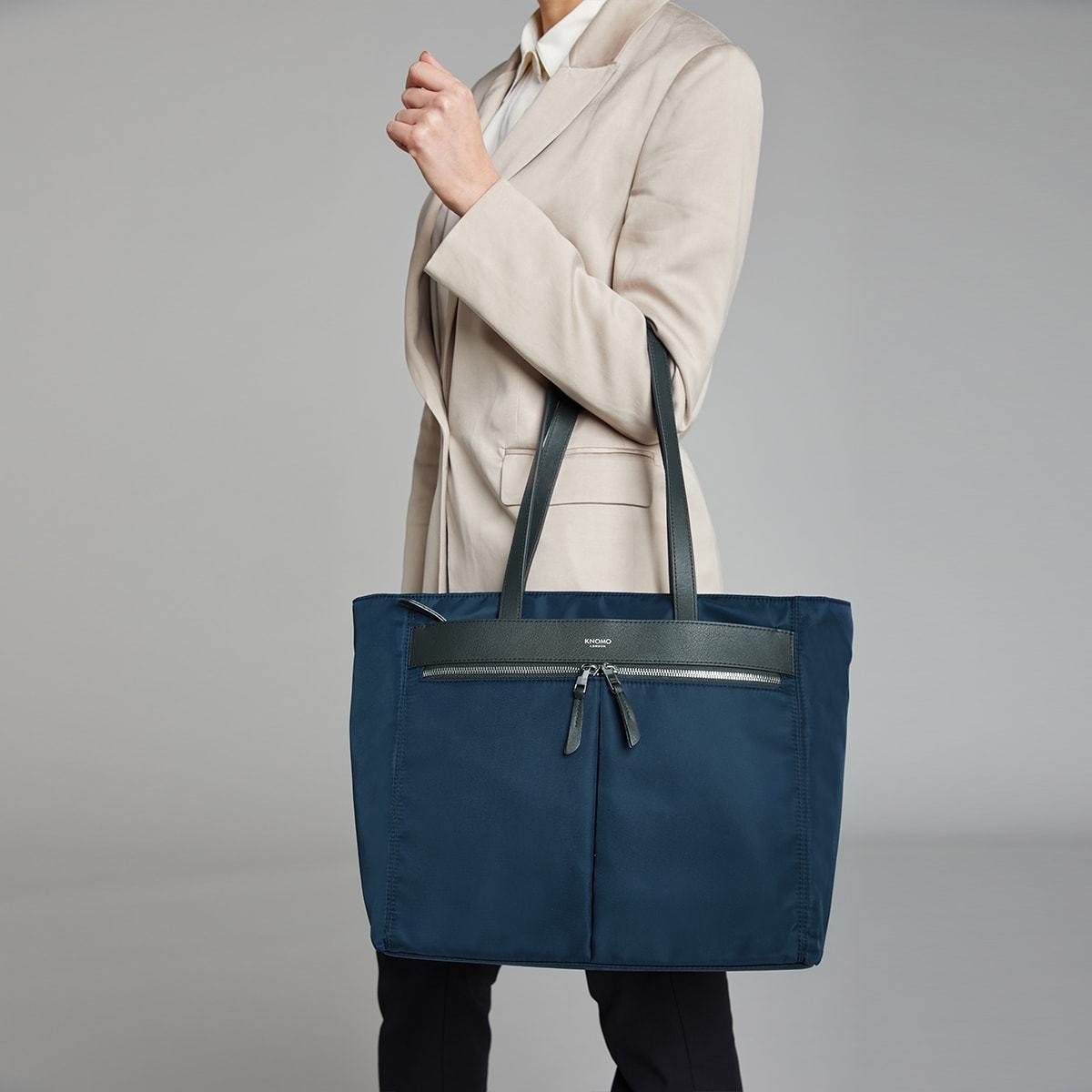 "KNOMO Grosvenor Place Tote Female Model Holding Straps 14"" -  Dark Navy Blazer 