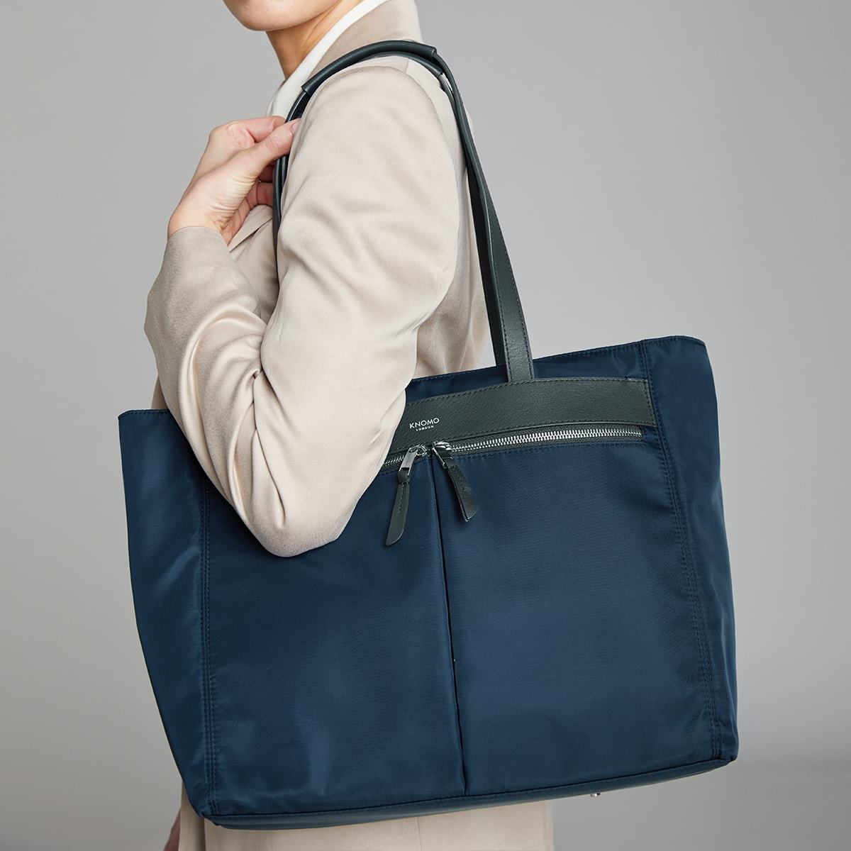 "KNOMO Grosvenor Place Tote Female Model Holding Over Shoulder 14"" -  Dark Navy Blazer 