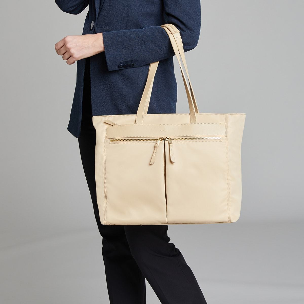 "KNOMO Grosvenor Place Tote Female Model Holding Straps 14"" -  Trench Beige 