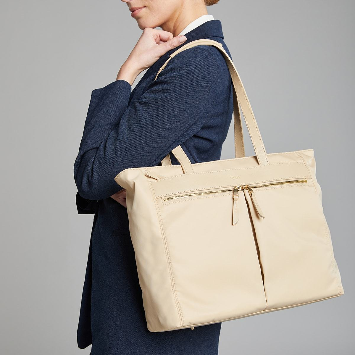"KNOMO Grosvenor Place Tote Female Model Holding Over Shoulder 14"" -  Trench Beige 