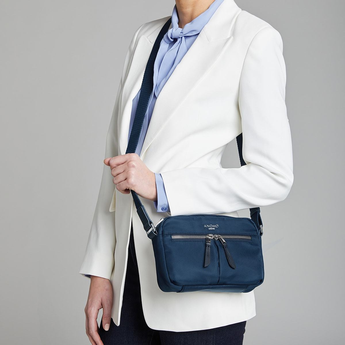 "KNOMO Avery Mini Cross-Body Female Model Wearing 10.5"" -  Dark Navy Blazer 