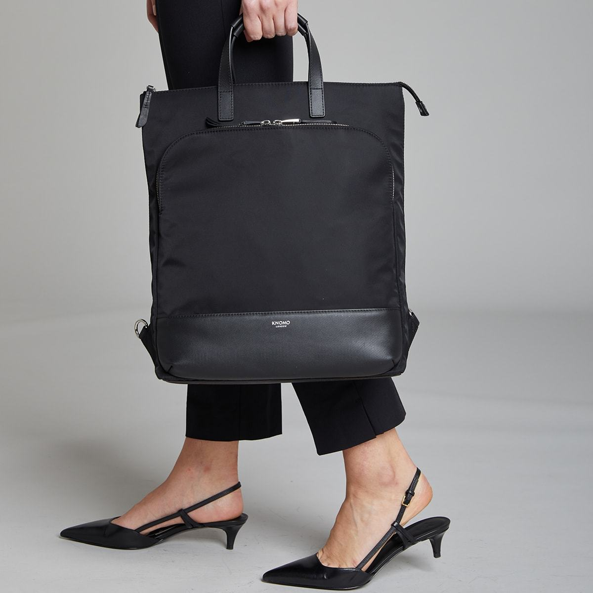 "KNOMO Harewood Laptop Tote Backpack Female Model Holding By Straps 15"" -  Black 