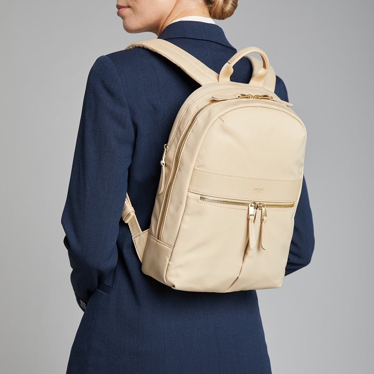 "KNOMO Mini Beaufort Backpack Female Model Wearing 12"" -  Trench Beige 