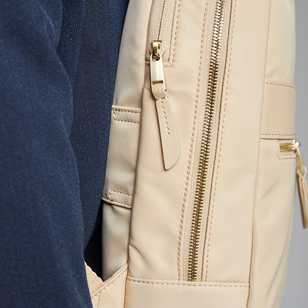 "KNOMO Mini Beaufort Backpack Female Model Close Up From Side 12"" -  Trench Beige 