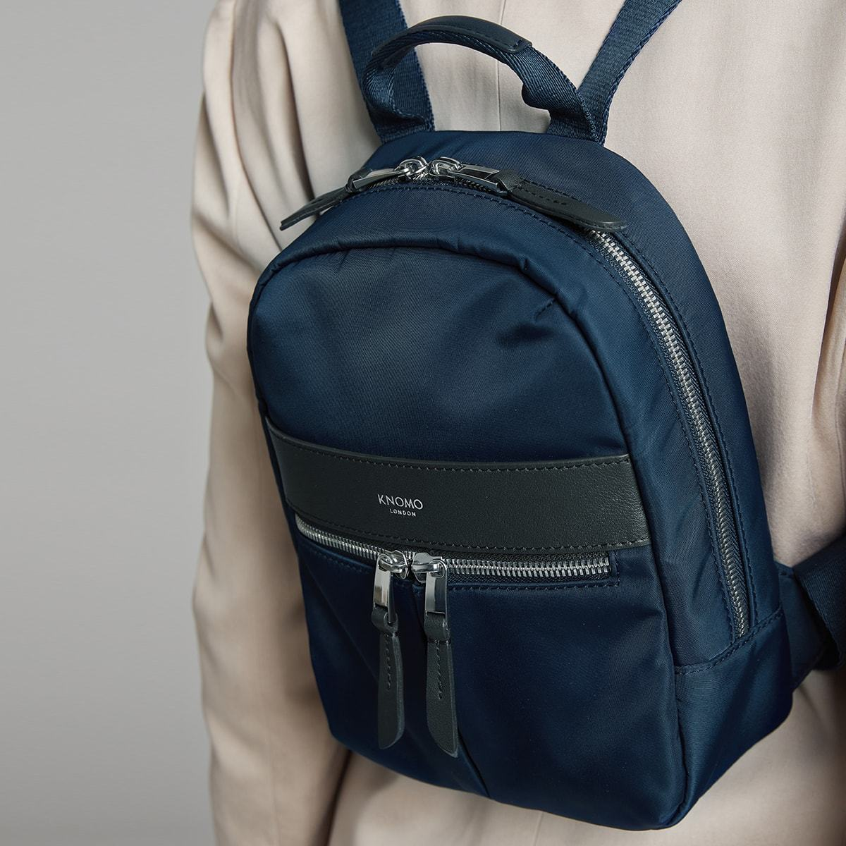 "KNOMO Beauchamp XS Backpack Female Model Close Up Wearing 8"" -  Dark Navy Blazer 