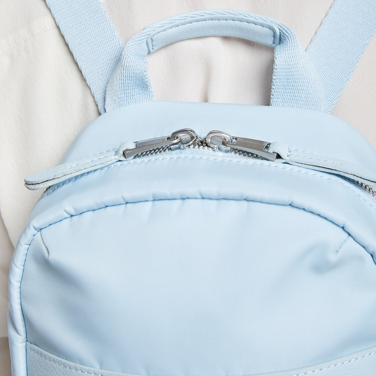 "KNOMO Beauchamp XS Backpack Female Model Close Up Wearing 8"" -  Poplin Blue 