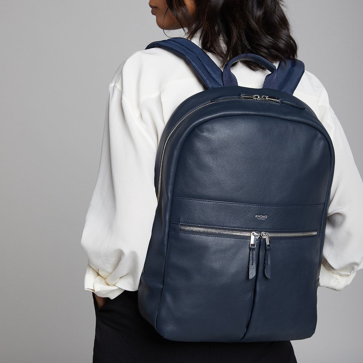 "KNOMO Beaux Leather Laptop Backpack Female Model Wearing 14"" -  Dark Navy Blazer 
