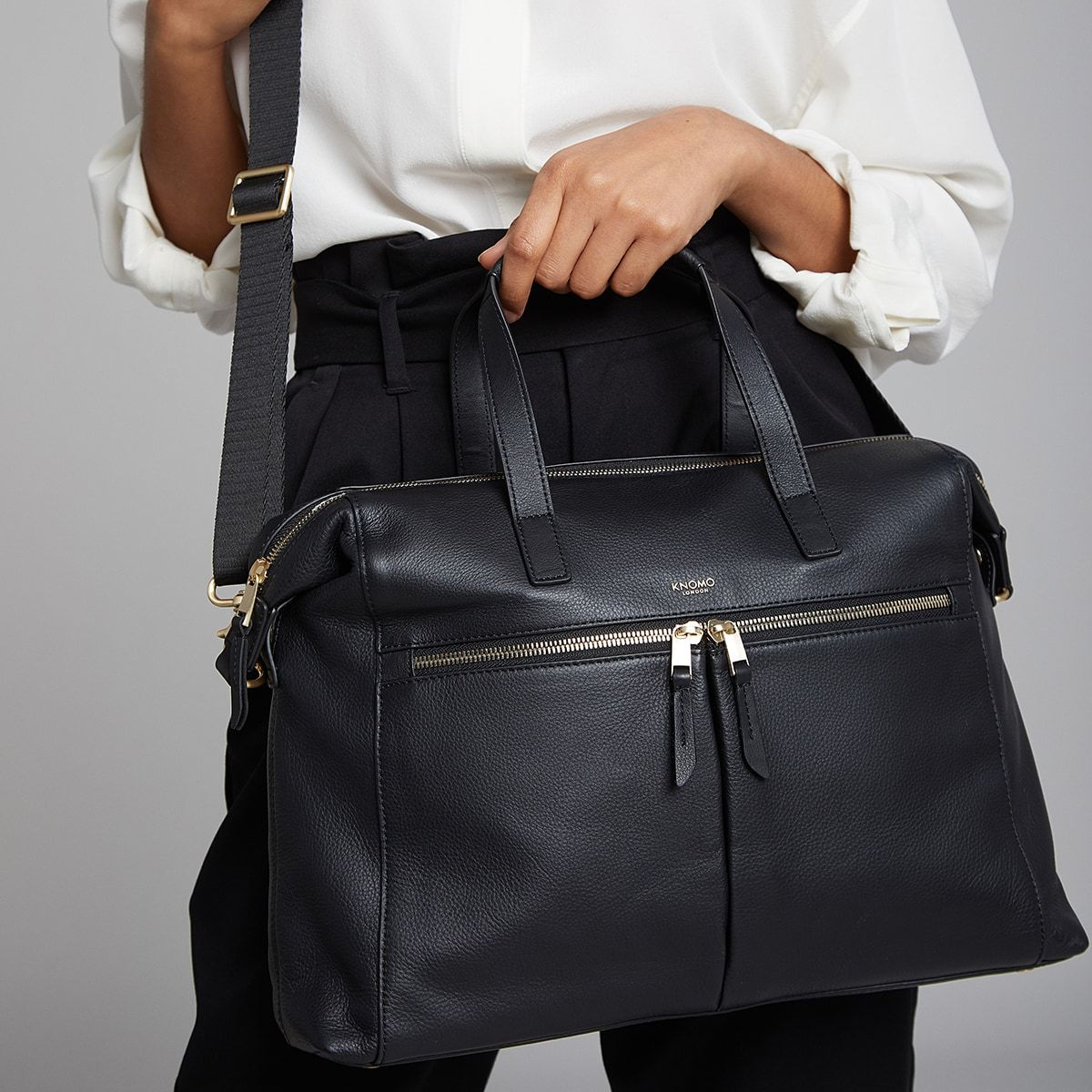 "KNOMO Audley Laptop Handbag Female Model Holding By Straps 14"" -  Black 