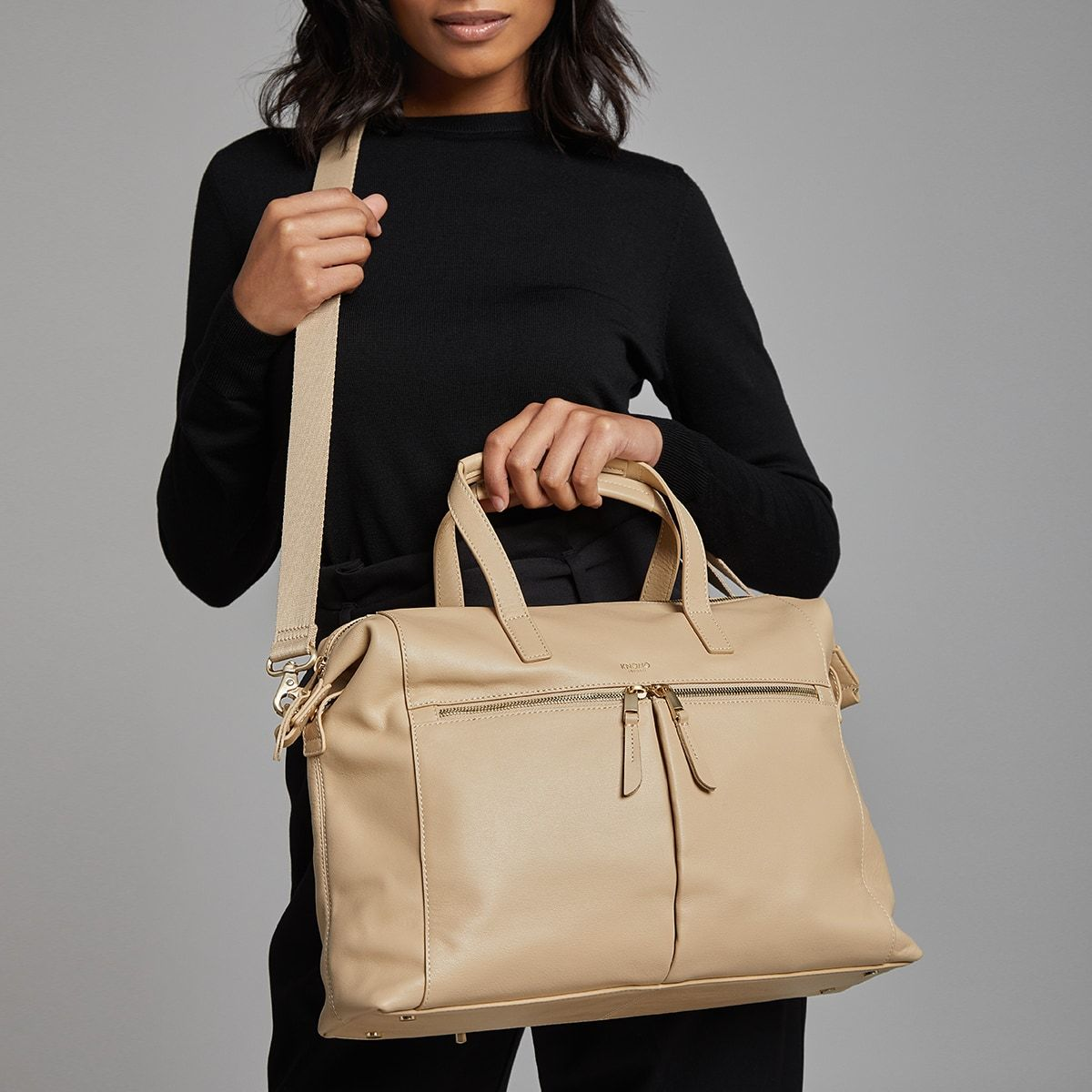 "KNOMO Audley Laptop Handbag Female Model Wearing Over Shoulder 14"" -  Trench Beige 
