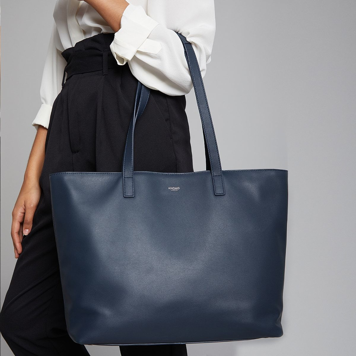 "KNOMO Maddox Laptop Tote Female Model Holding Straps 15"" -  Dark Navy Blazer 