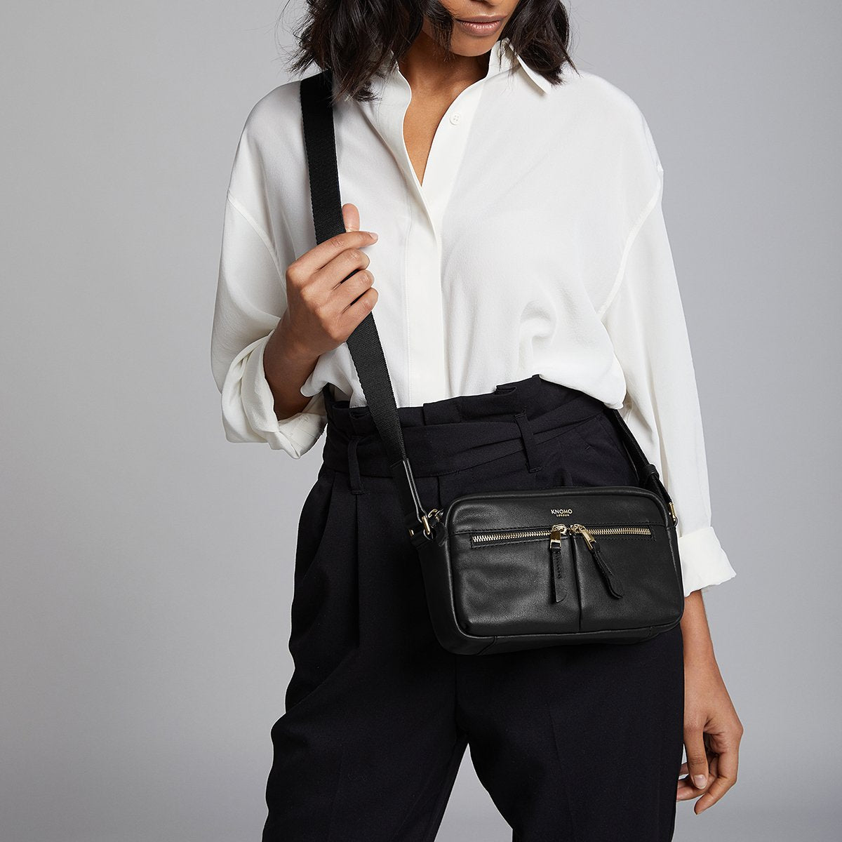 "KNOMO Brook Mini Cross-Body Female Model Wearing Over Shoulder 10.5"" -  Black 