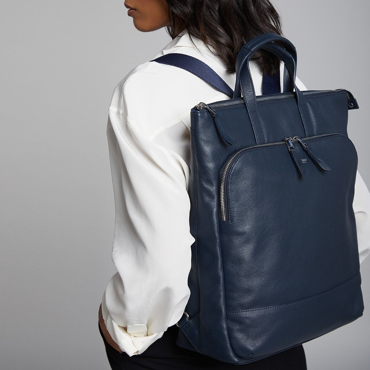 "KNOMO Harewood Laptop Tote Backpack Female Model Wearing 15"" -  Dark Navy Blazer 