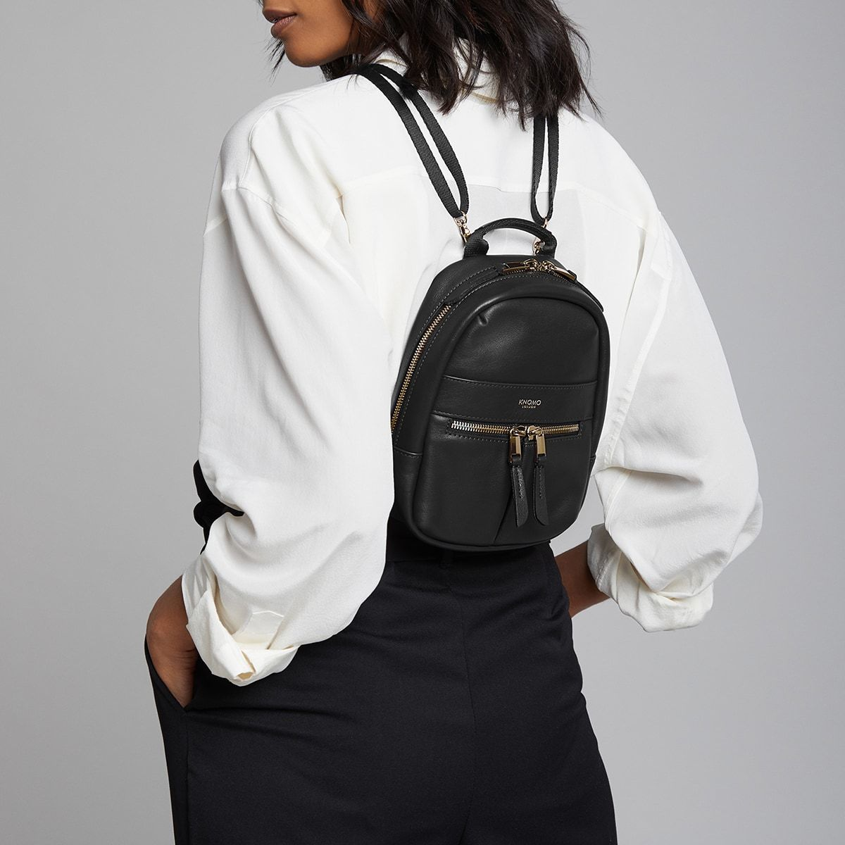 "KNOMO Beauchamp XXS Backpack / X-Body Female Model Wearing 6"" -  Black 