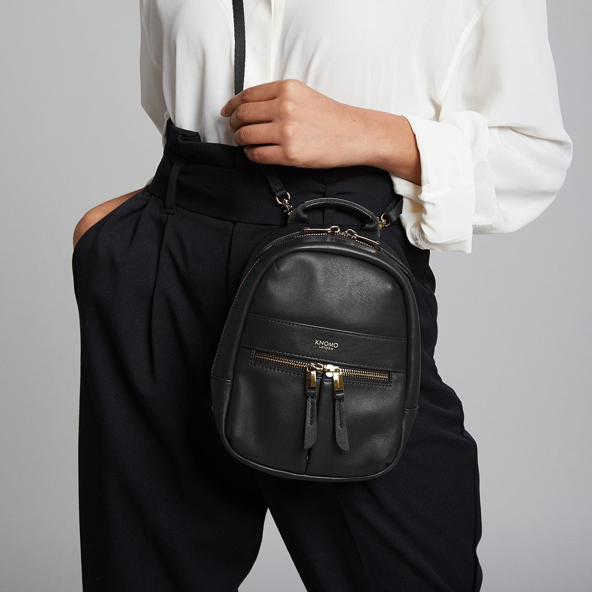 "KNOMO Beauchamp XXS Backpack / X-Body Female Model Wearing Close Up 6"" -  Black 