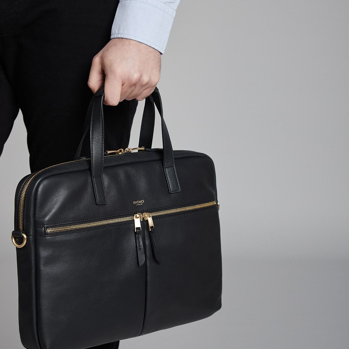 "KNOMO Hanover Laptop Briefcase Male Model Holding From Straps 14"" -  Black 