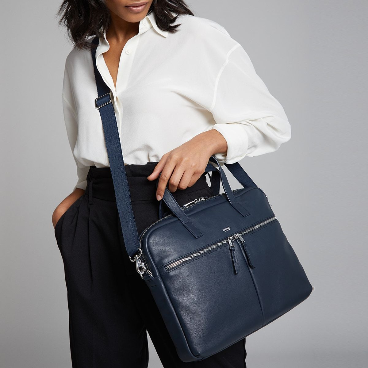 "KNOMO Hanover Laptop Briefcase Female Model Wearing Over Shoulder 14"" -  Dark Navy Blazer 