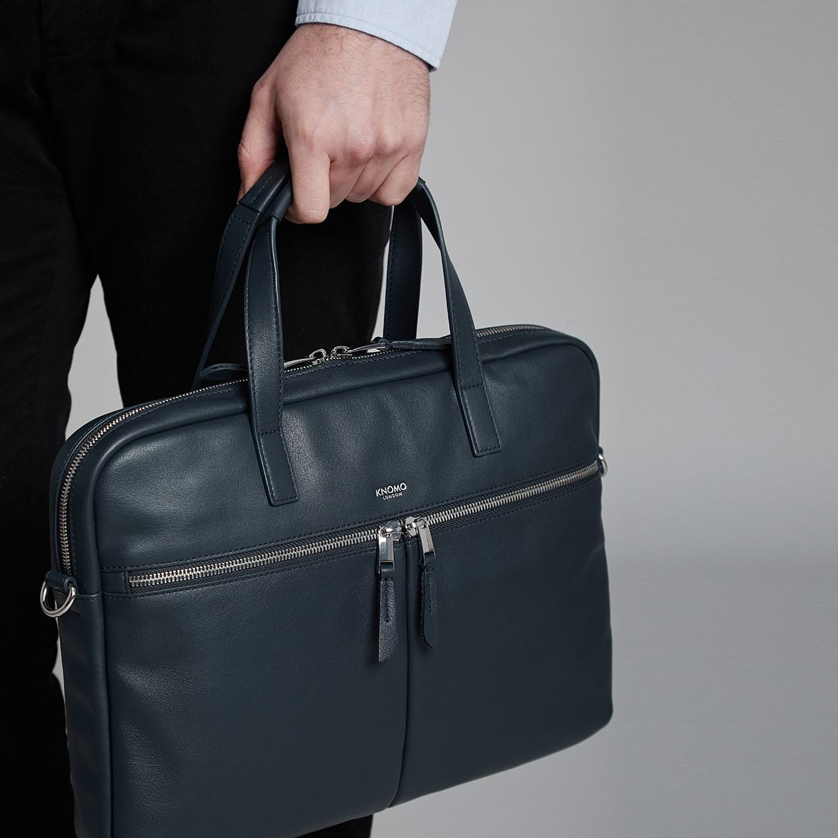 "KNOMO Hanover Laptop Briefcase Male Model Holding From Straps 14"" -  Dark Navy Blazer 