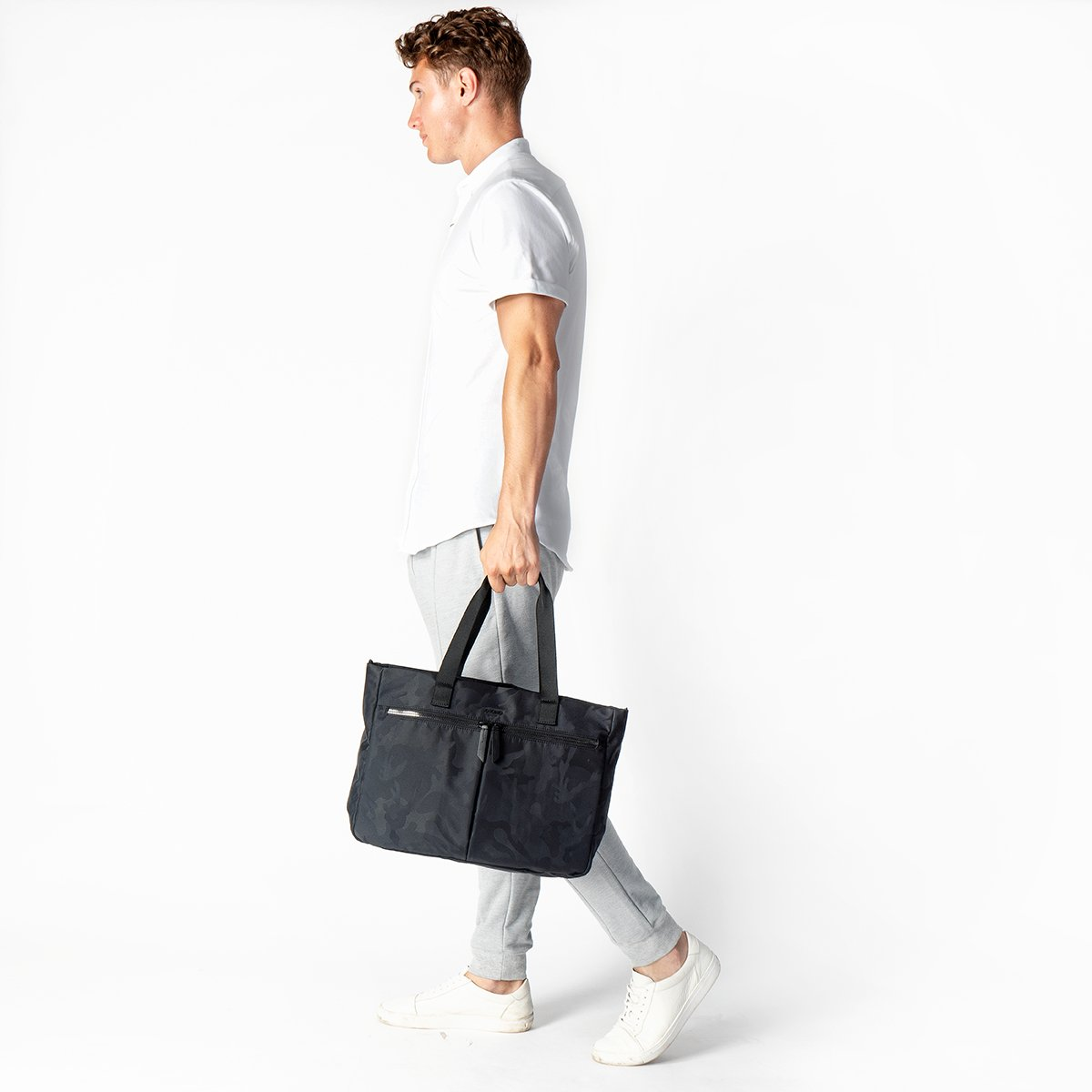 "KNOMO Cologne Tote Male Model Holding From Straps 14"" -  Black Camouflage 