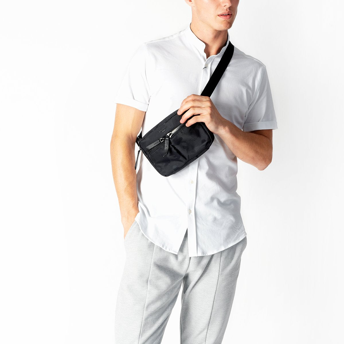 "KNOMO Hanoi Mini Cross-Body Male Model Wearing Over Shoulder 10.5"" -  Black Camouflage 