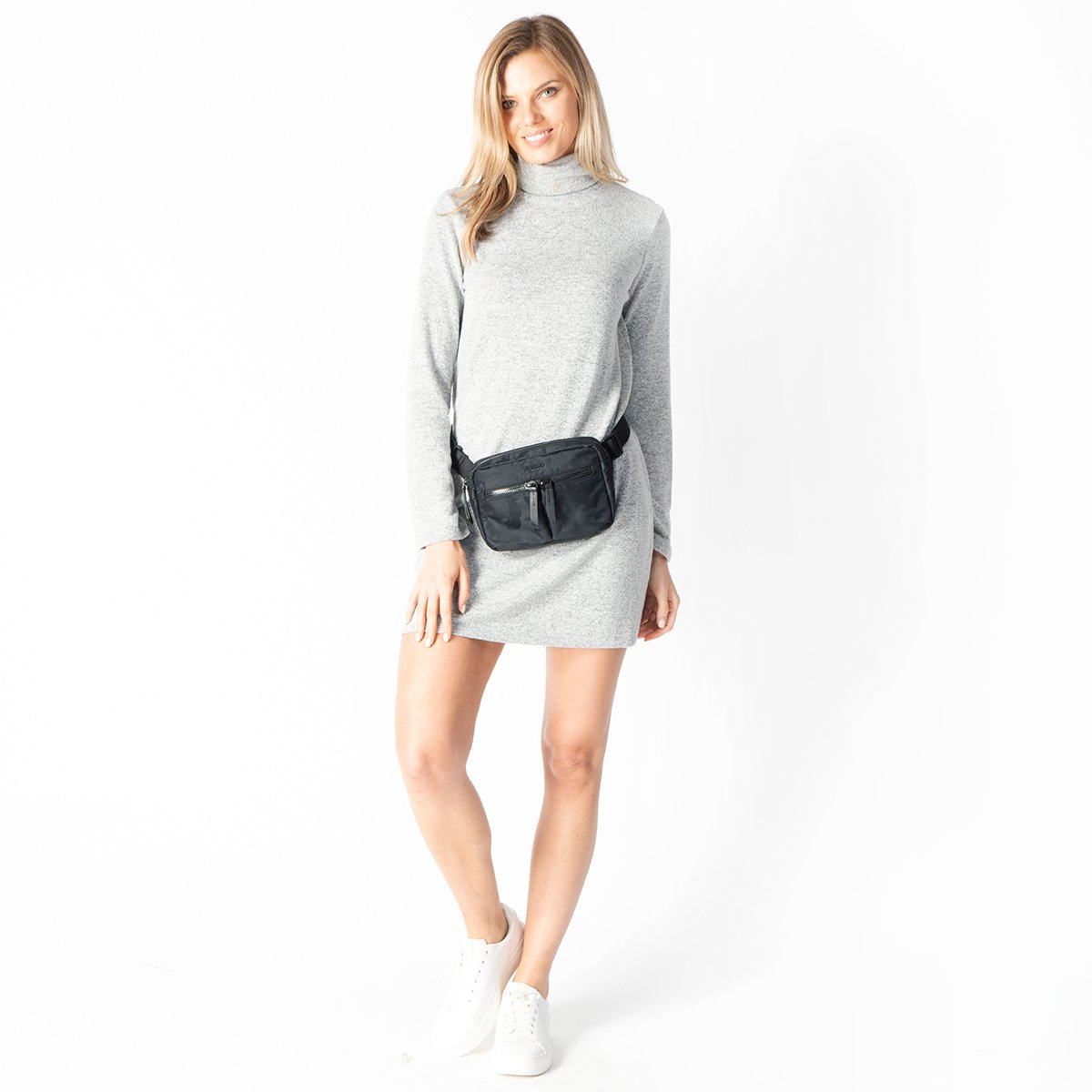 "KNOMO Hanoi Mini Cross-Body Female Model Wearing Around Waist 10.5"" -  Black Camouflage 