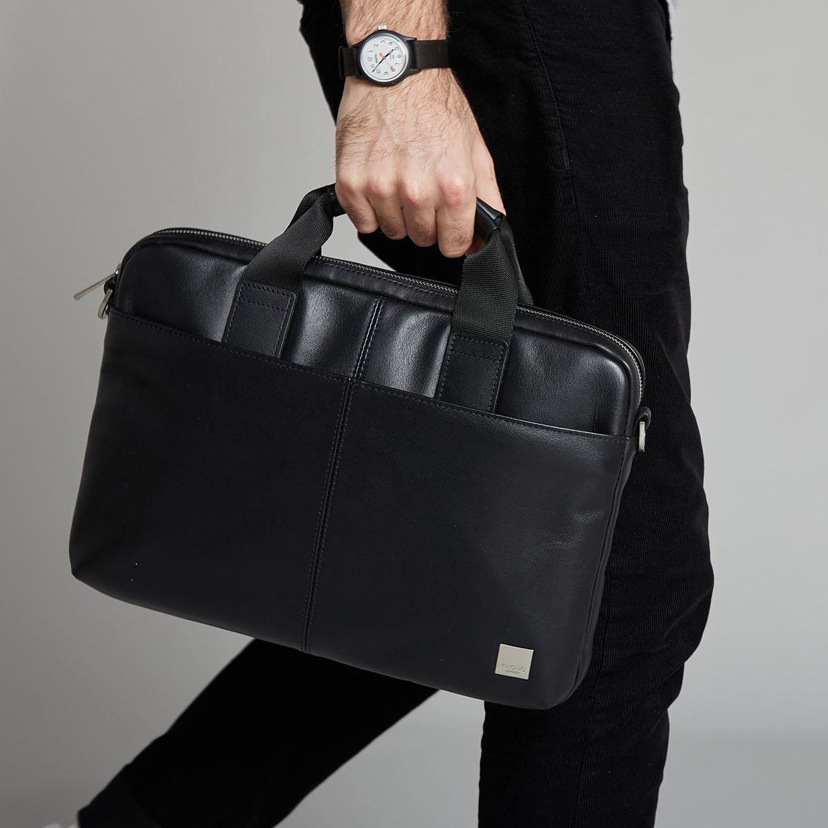 "KNOMO Stanford Laptop Briefcase Male Model Holding By Side 13"" -  Black 