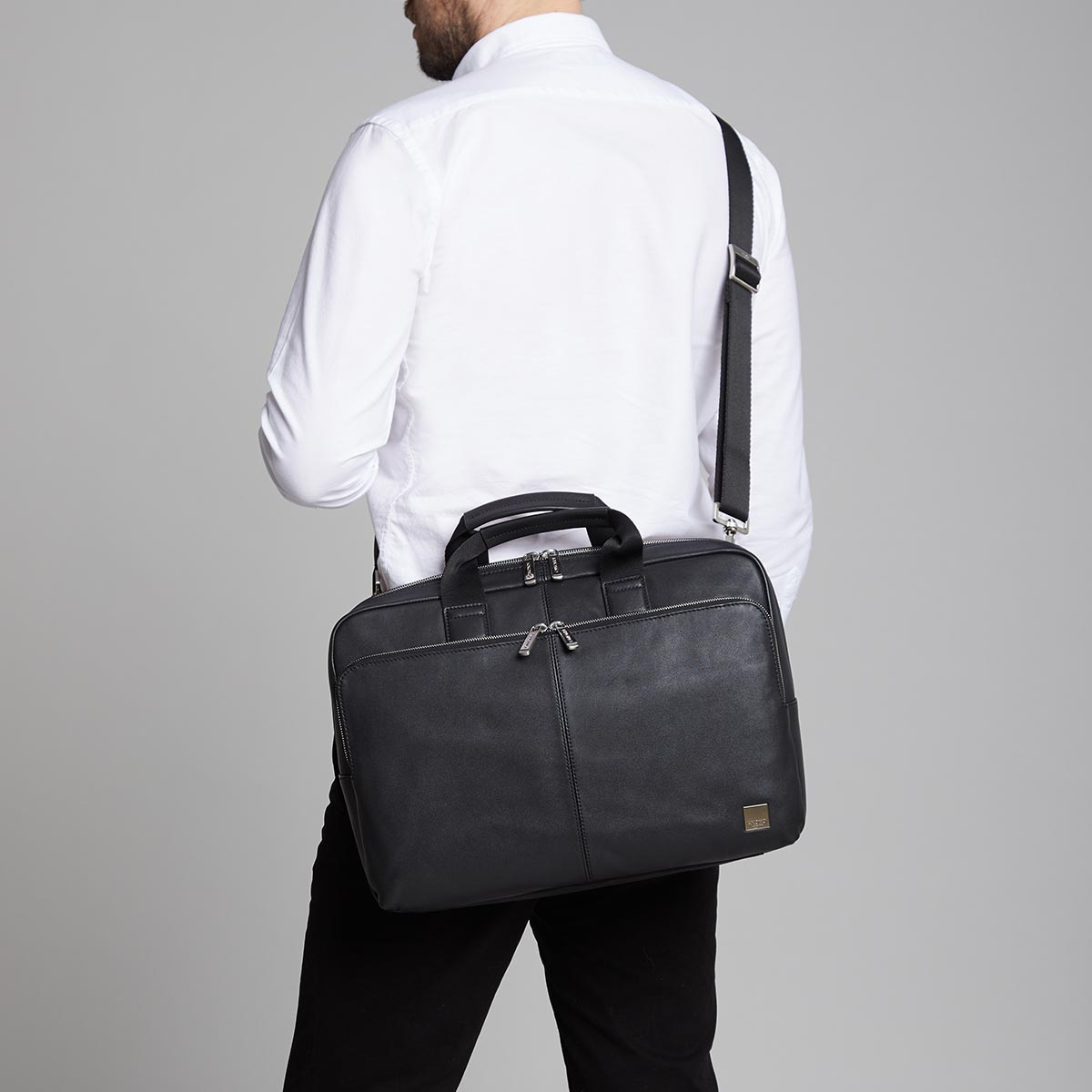 "KNOMO Newbury Laptop Briefcase Male Model Wearing Over Shoulder 15"" -  Black 