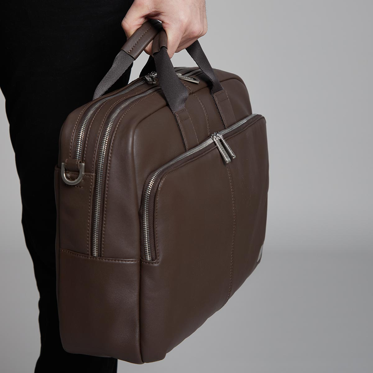 "KNOMO Amesbury Laptop Briefcase Male Model Holding 15"" -  Brown 