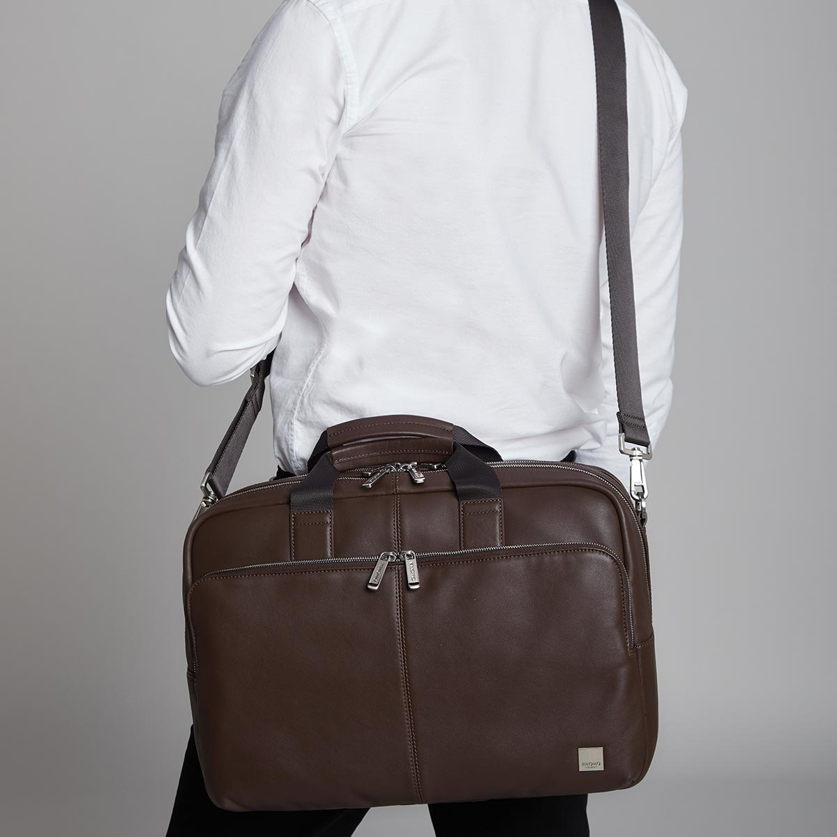 "KNOMO Amesbury Laptop Briefcase Male Model Wearing Over Shoulder 15"" -  Brown 