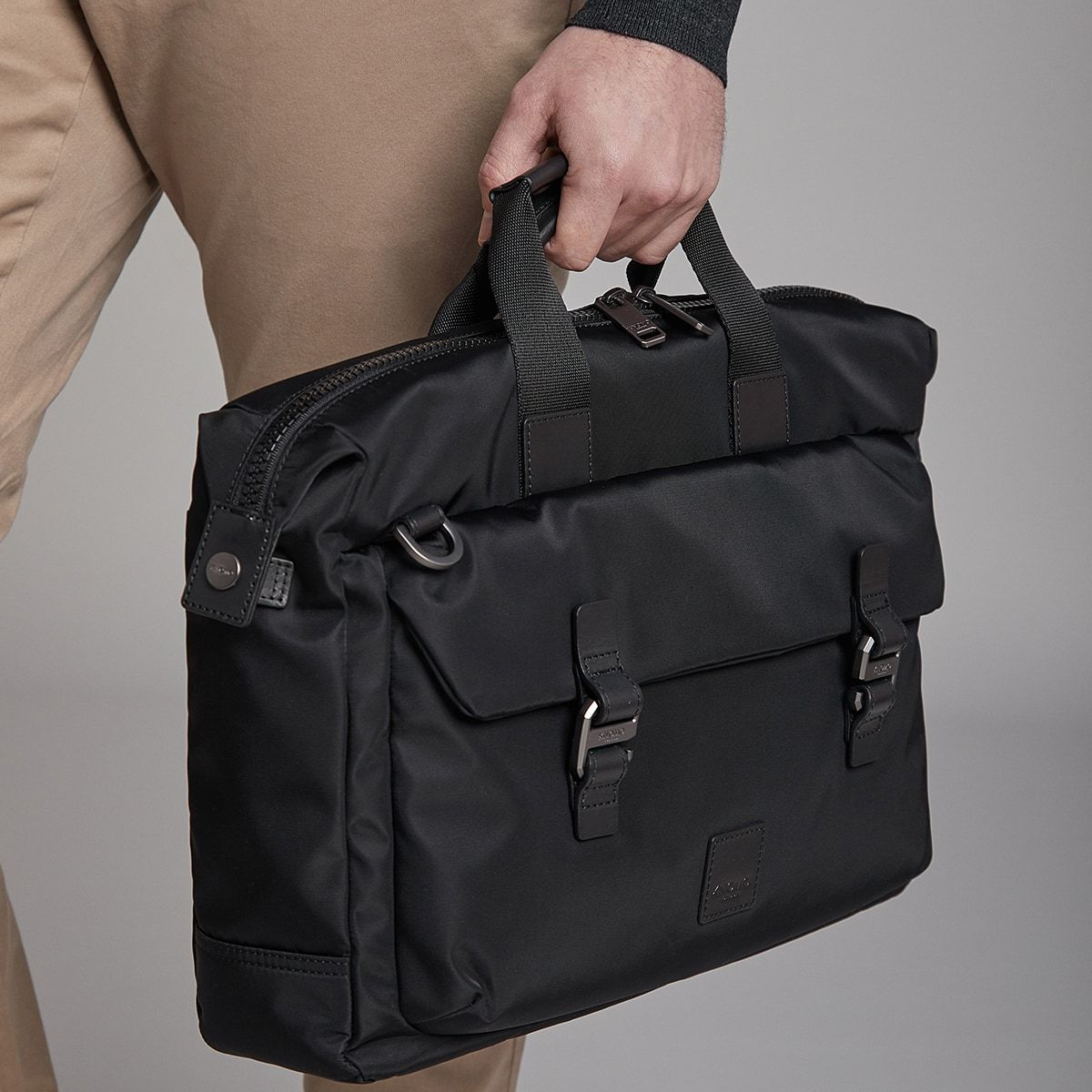"KNOMO Tournay Laptop Briefcase Male Model Holding Strap 15"" -  Black 