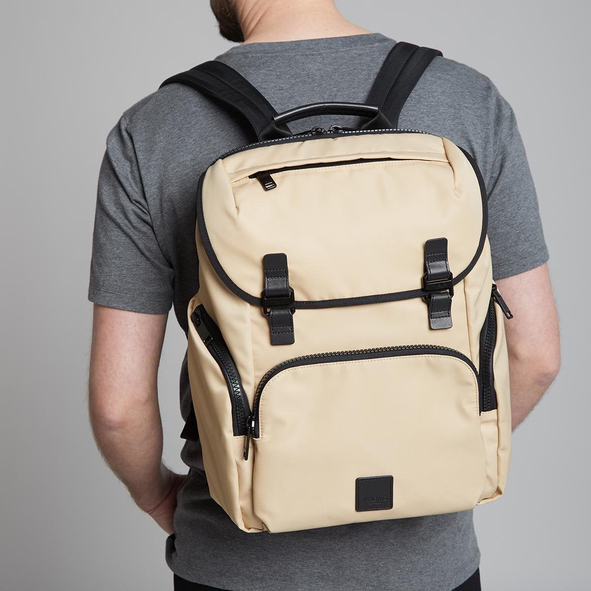 "KNOMO Thurloe Backpack Male Model Wearing 15"" -  Trench Beige 