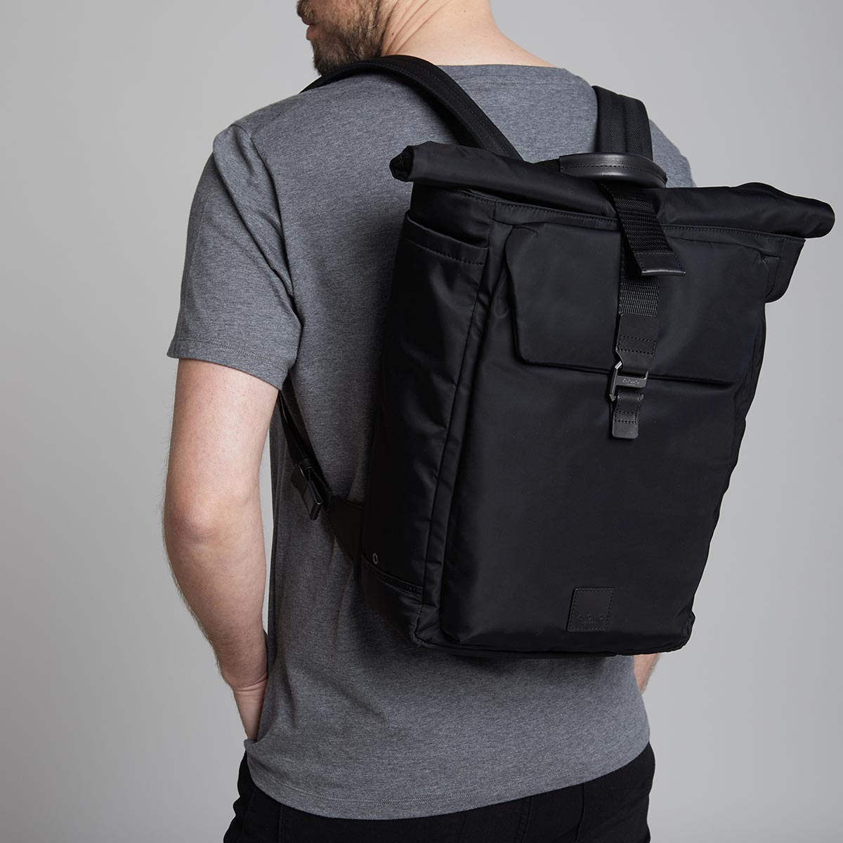 "KNOMO Novello Roll-Top Laptop Backpack Male Model Wearing 15"" -  Black 