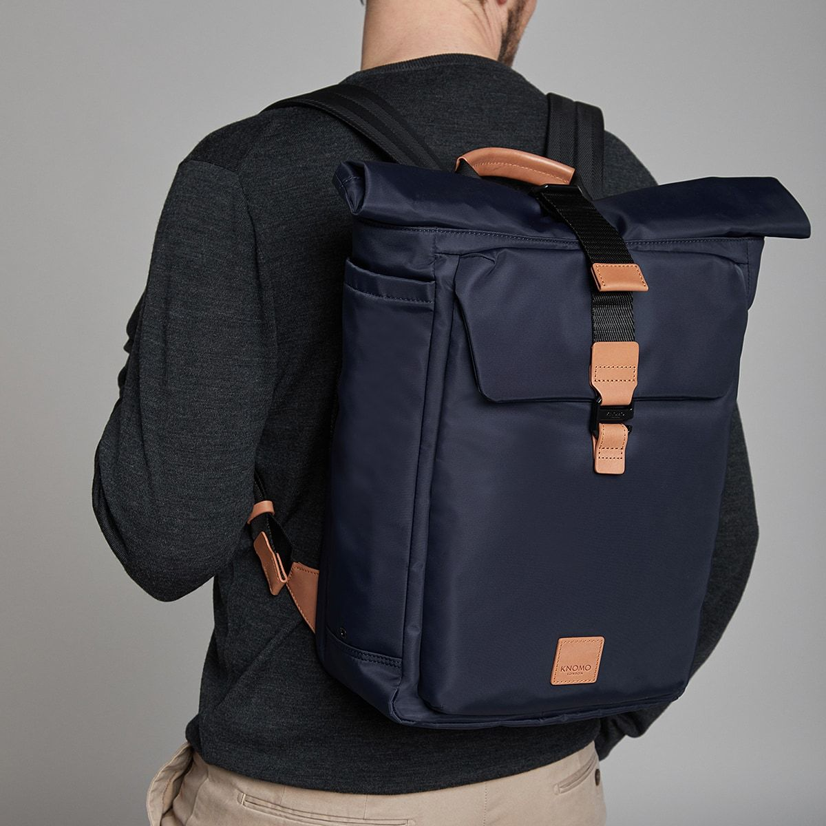 "KNOMO Novello Roll-Top Laptop Backpack Male Model Wearing 15"" -  Dark Navy 