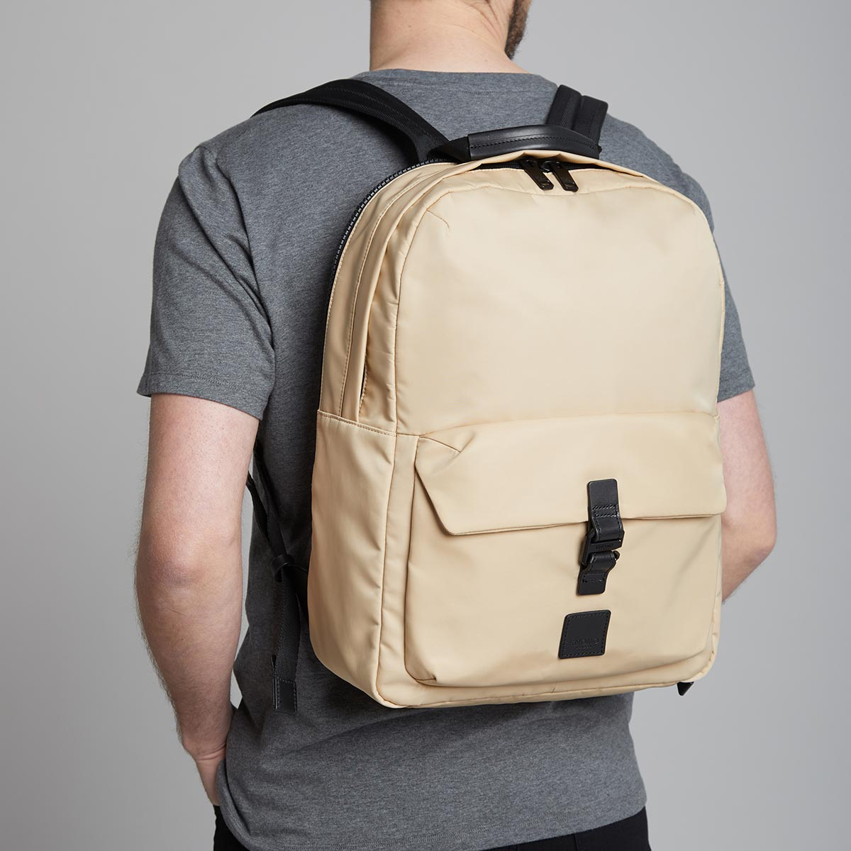 "KNOMO Christowe Backpack Male Model Wearing 15"" -  Trench Beige 