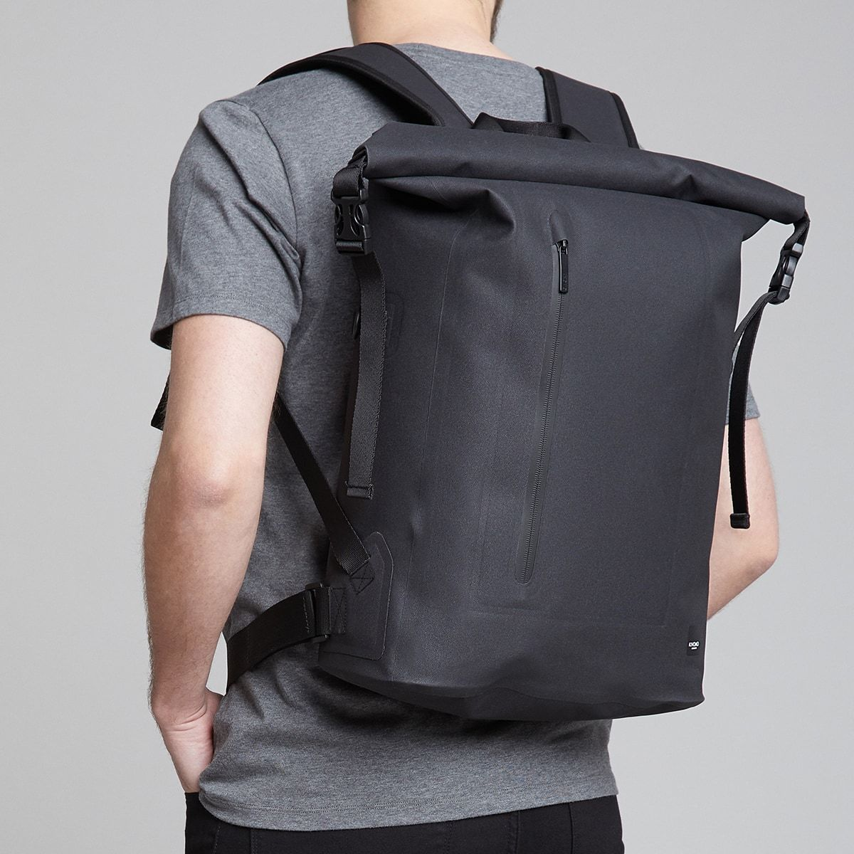 "KNOMO Cromwell Roll-Top Laptop Backpack Male Model Wearing 14"" -  Black 