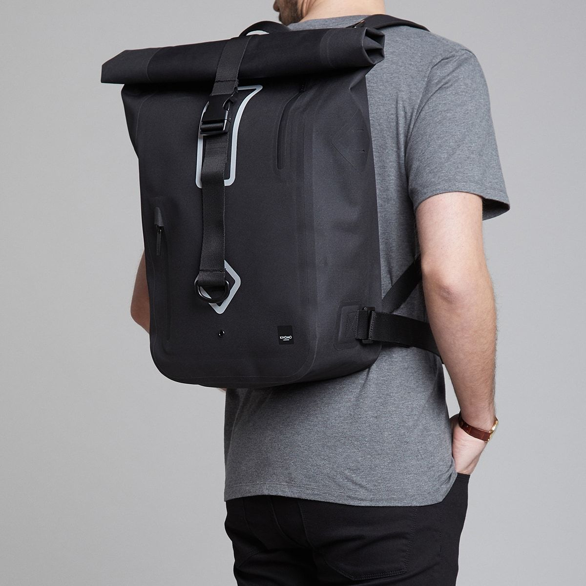 "KNOMO Kew Roll-Top Laptop Backpack Male Model Wearing 15"" -  Black 