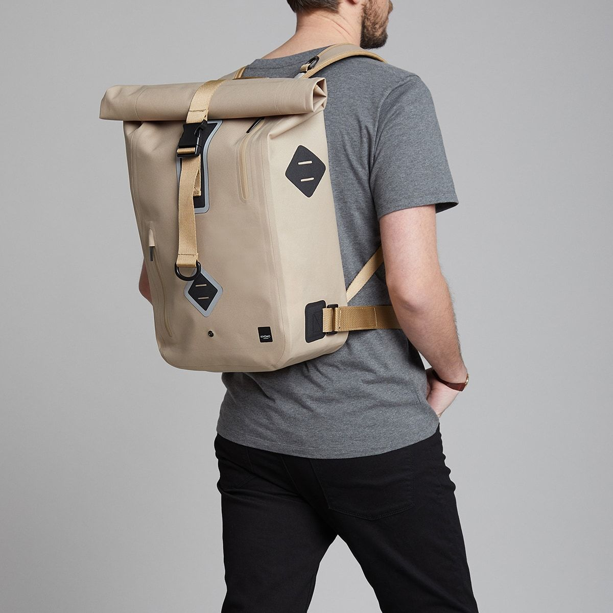 "KNOMO Kew Roll-Top Laptop Backpack Male Model Wearing 15"" -  Desert 