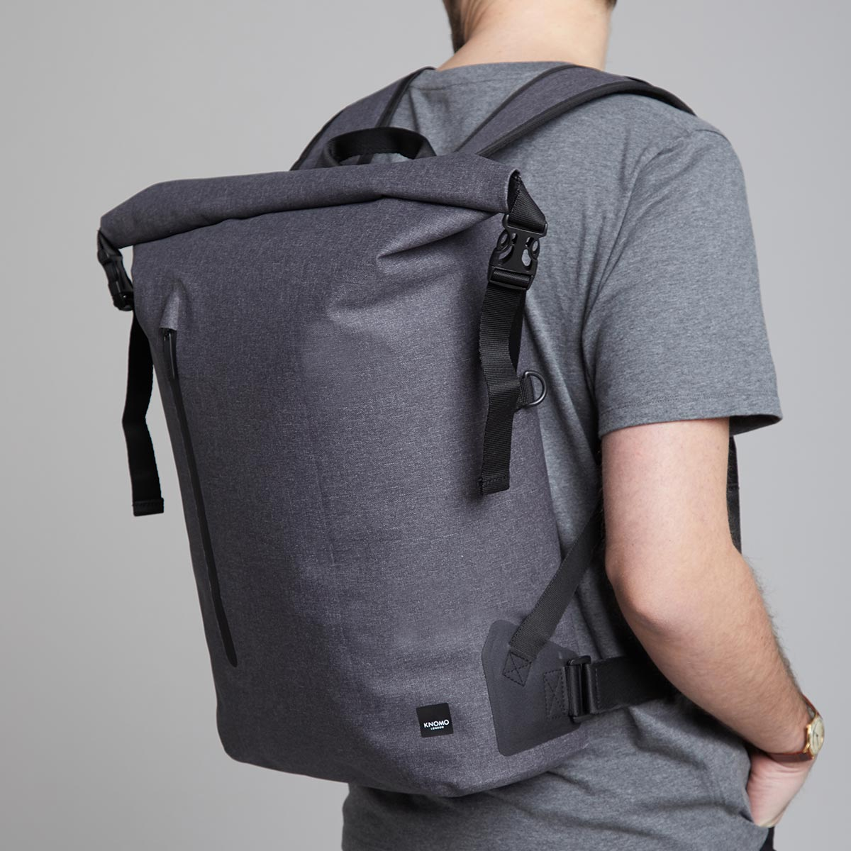 "KNOMO Cromwell Roll-Top Laptop Backpack Male Model Wearing Close Up 14"" -  Grey 
