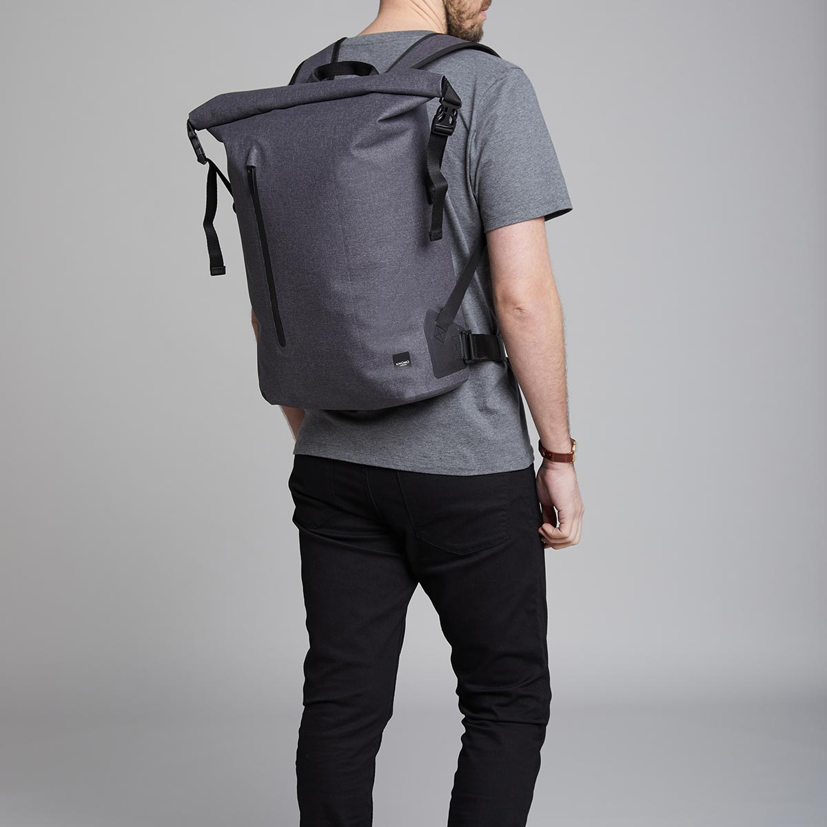 "KNOMO Cromwell Roll-Top Laptop Backpack Male Model Wearing 14"" -  Grey 