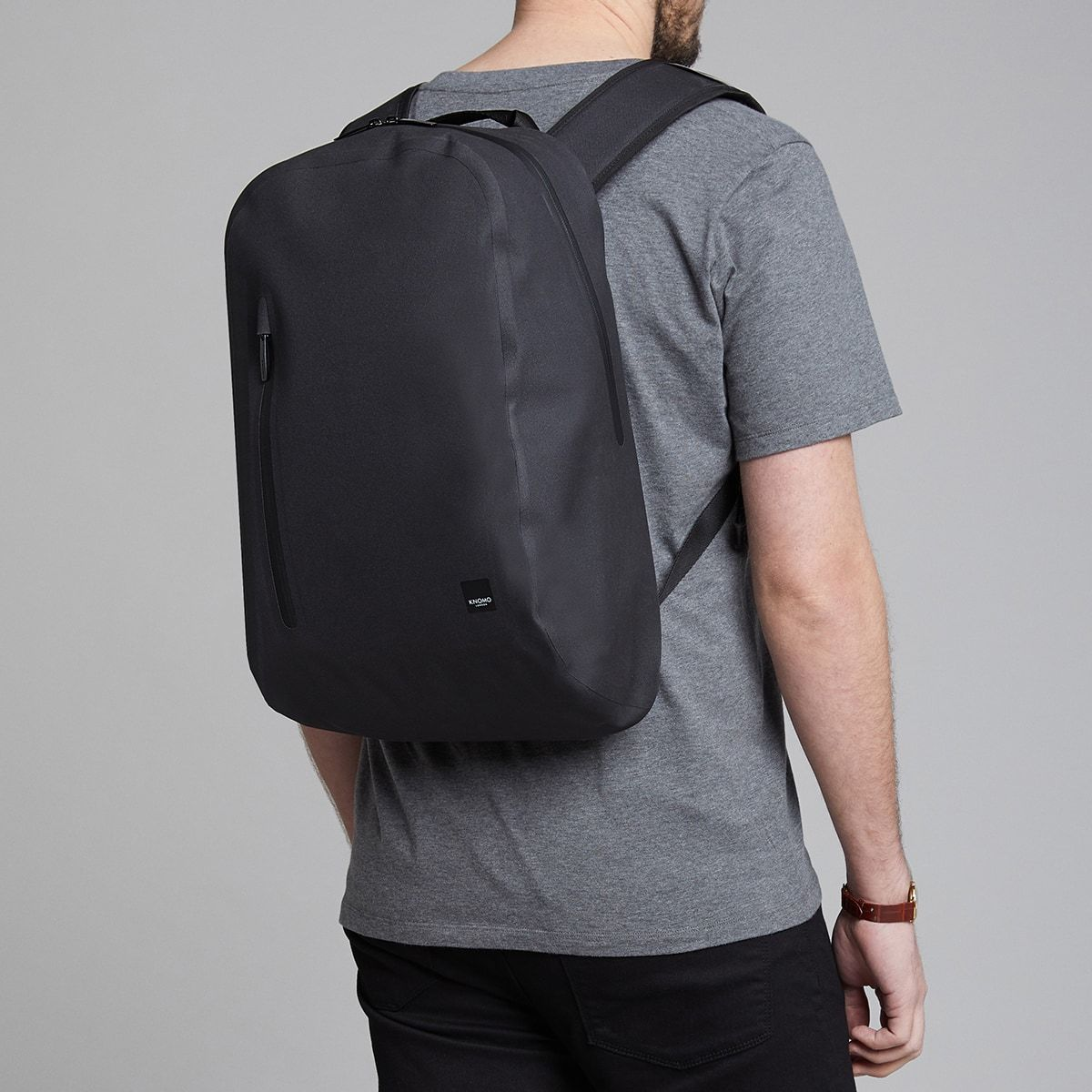 "KNOMO Harpsden Laptop Backpack Male Model Wearing 14"" -  Black 