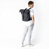 "KNOMO Kew Roll-Top Laptop Backpack Male Model Wearing 15"" -  Grey 