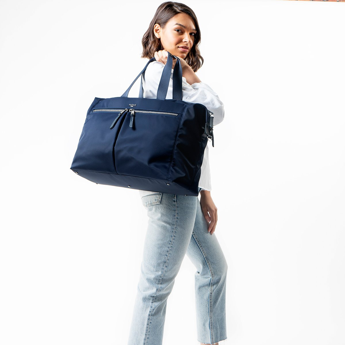 "KNOMO Stratton Duffle/Tote Female Model Holding Over Shoulder 15"" -  Dark Navy 