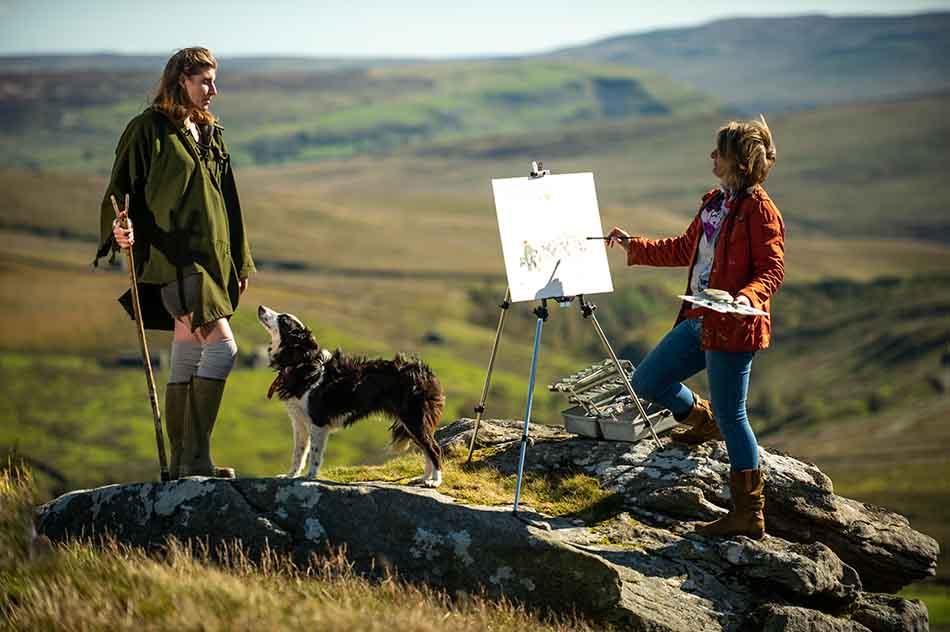 Anita Bowerman painting The Yorkshire Shepherdess and her sheepdog at Ravenseat