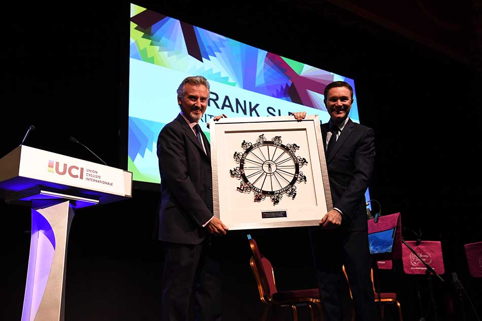 Chairman of British Cycling presents artwork to President of UCI
