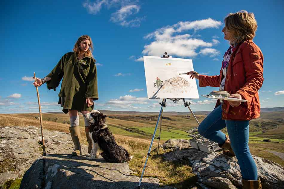 Anita Bowerman painting The Yorkshire Shepherdess and her sheepdog