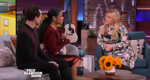 Susan Kelechi Watson Wears a red Cavanagh Baker skirt on The Kelly Clarkson Show