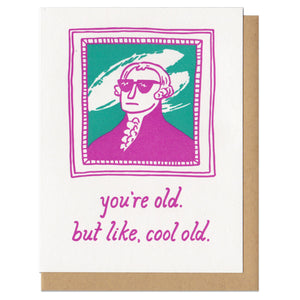 "greeting card with a pink and teal illustration of George Washington wearing sunglasses in frame. Text below reads, ""you're old. but like, cool old"""
