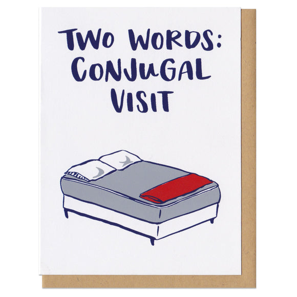 white greeting card with an illustrated double bed benath navy text that reads