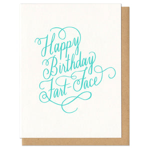 "Greeting card and kraft paper envelope. Text reads ""happy birthday fart face"" in ornate, script, hand-drawn, mint colored letters."