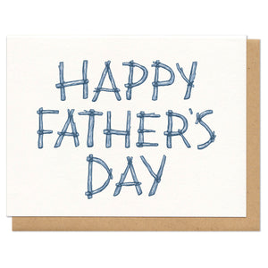 "Greeting card and kraft paper envelope. Written in sticks, the card reads, ""happy father's day"""